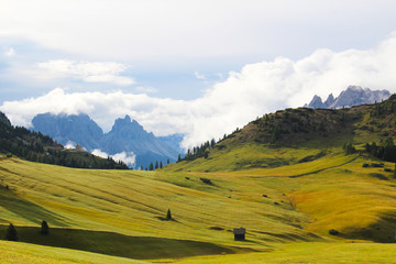 Mountain landscape of the Dolomites, with green pastures and mountain peaks, Dolomites, Italy