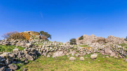 Remains of nuraghe or fortress from the bronze age at Archeological site of Tamuli, Sardinia island, Italy