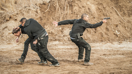 Bodyguard and VIP people security protection. Combat gun shooting training
