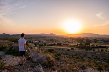 Man watching the sunset in a mountain