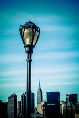 Wall Mural - Black city lamp post with New York City Manhattan skyline in the background