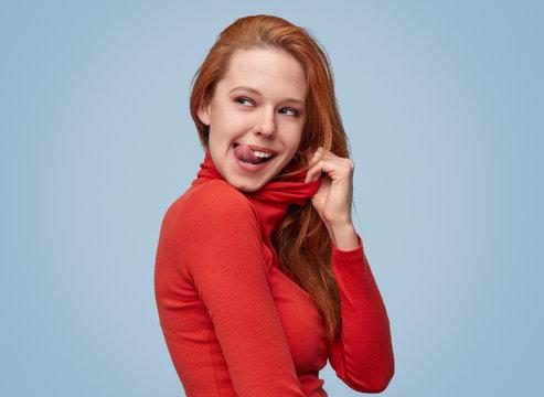 Ginger female licking lips
