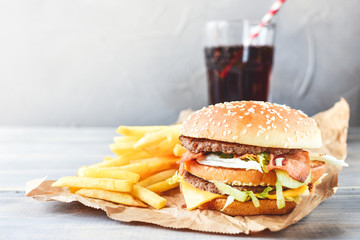 double cheeseburger with fries. takeaway lunch, fast food restaurant, fast food menu. light background, selective focus and copy space