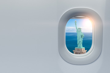 Airplane window with view on Statue of Liberty, New York, USA. Travel, tourism ando trip to USA concept.