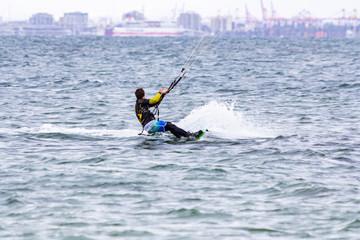Man doing kitesurf in Australian beach in Melbourne.