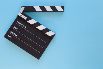 black clapperboard with free space for text isolated on color background