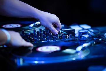 Hand of hip hop dj scratching vinyl records with music