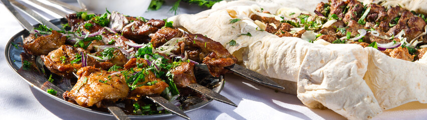 Panoramic image shashlik with lavash and vegetables