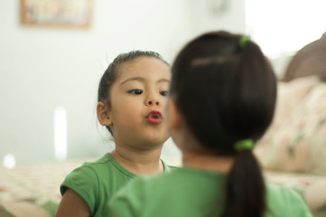 Girl trying on lipstick
