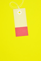 rectangle paper tag on yellow background vertical template