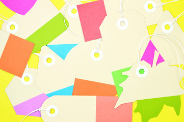 bunch of colorful paper tags on yellow background horizontal template