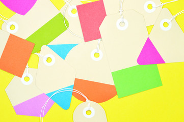 bunch of paper tags on yellow background horizontal template