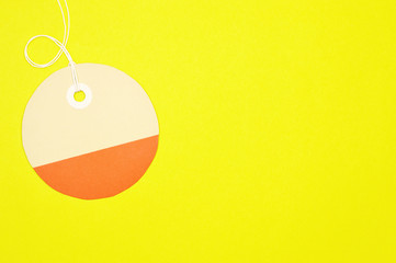 circle paper tag on yellow background horizontal template