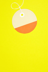 circle paper tag on yellow background vertical template