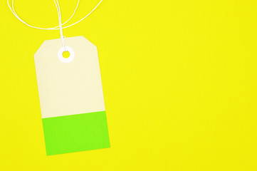 clipped rectangle paper tag on yellow background horizontal template