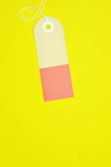 curved rectangle paper tag on yellow background vertical template