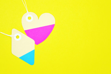 diamond and heart paper tags on yellow background
