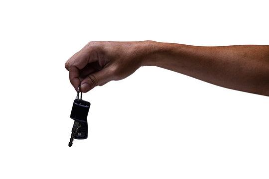 man hand holding car keys isolated on white background. Close up