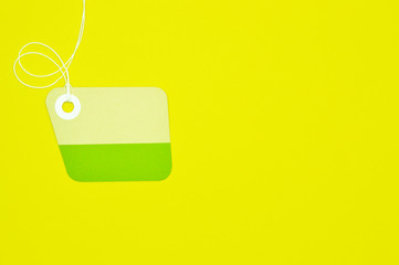 irregular paper tag on yellow background horizontal template
