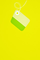 irregular paper tag on yellow background vertical template