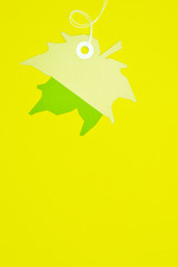 leaf paper tag on yellow background vertical template