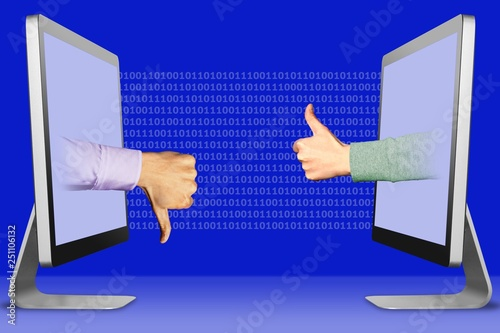 online concept, two hands from monitors  thumbs down, dislike and