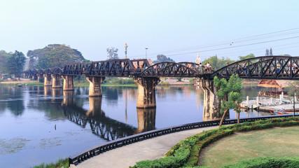 KANCHANABURI, THAILAND - FEBRUARY 17, 2019_Tourists visit The River Kwai Bridge in Kanchanaburi Province. This steel bridge is one of important historical landmarks and memorials in Thailand