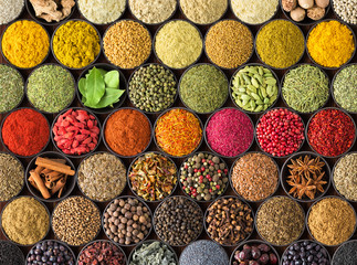 colorful spice background, top view.  seasonings and herbs for European food