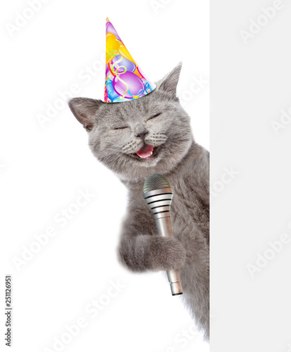 Cat In Birthday Hat Holds Microphone Isolated On White Background