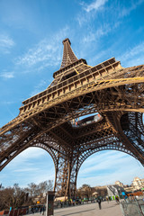 Wide shot of Eiffel Tower with blue sky in Paris