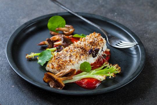 Halibut with hazelnut crust with roast red pepper sauce, asparagus, cauliflower and shiitake mushrooms