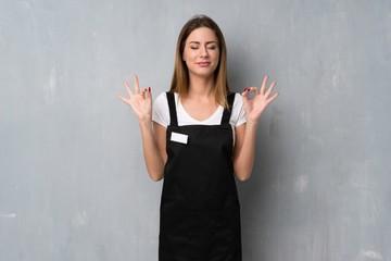 Obraz Employee woman in zen pose - fototapety do salonu