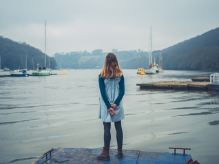 Young woman standing on jetty