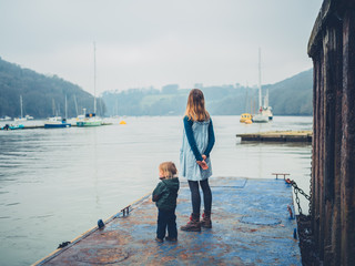 Young mother and toddler on old jetty
