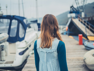 Young woman in marina with boats