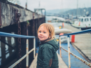 Little toddler walking around a marina