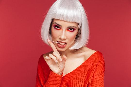 Beautiful young woman wearing bright makeup