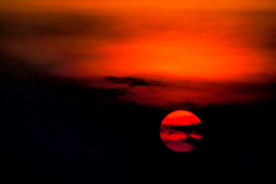 setting sun sunset  colors wave in  red orange contrast dark black sky nature amazing background
