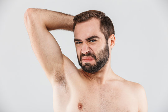 Close up portrait of a disgusted bearded man standing