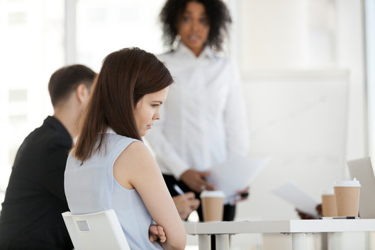 Young worker feels offended frustrated during meeting at work