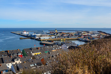 harbor in Island Helgoland, Germany, nordic style houses with boat and blue sky, panorama view from hill to north sea