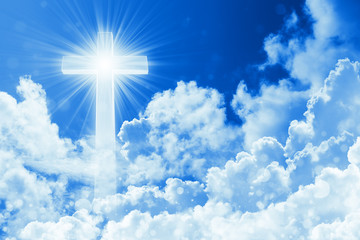 Concept of christian religion shining cross on the background of cloudy sky. Sky with cross and beautiful cloud. Divine shining heaven, light. Peaceful religious background Wall mural
