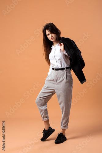 ec7c7e178e4 Dark-haired girl dressed in white shirt