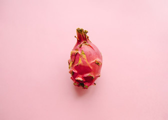 Dragon fruit Top view photo Fresh pitaya is lying on a pink background Template for posters with copy space