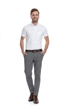 happy confident casual man standing with hands in pockets