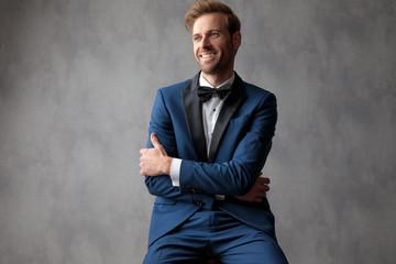Elegant man sitting with his hands crossed