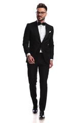 elegant man stepping forward while looking sideways