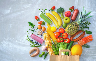 Shopping bag with groceries full of fresh vegetables and fruits Wall mural