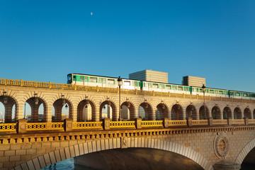 Bridge pont de Bercy in Paris with metro on it
