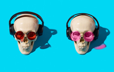 skull pattern with glasses on a blue background